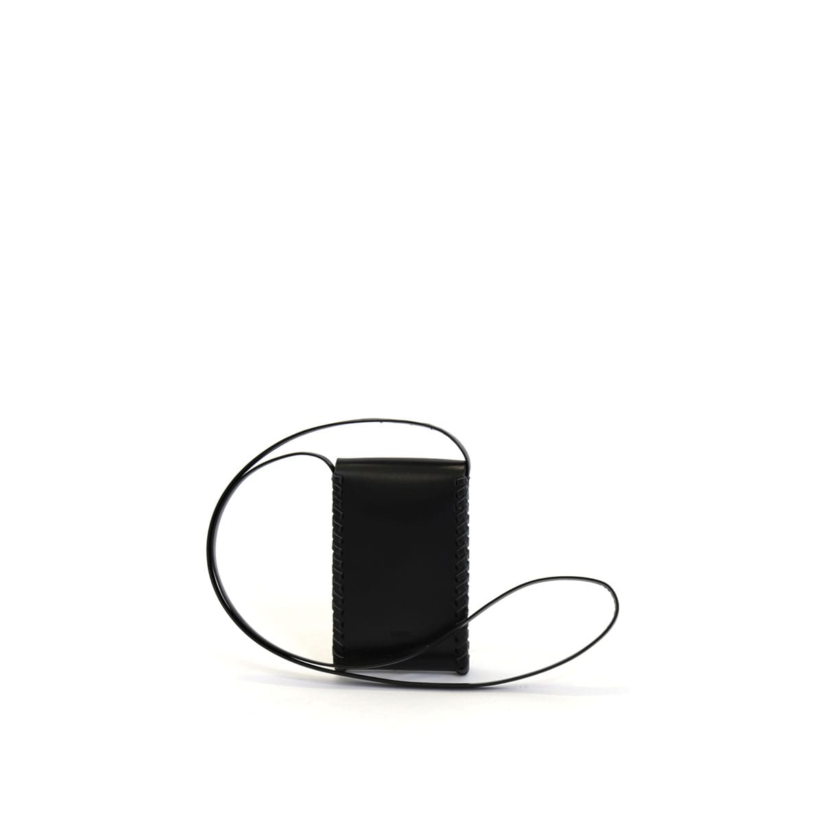 LUMI Kimmo Neck Phone Case, in black, is created using natural vegetable tanned cow leather. The color will naturally change over time.