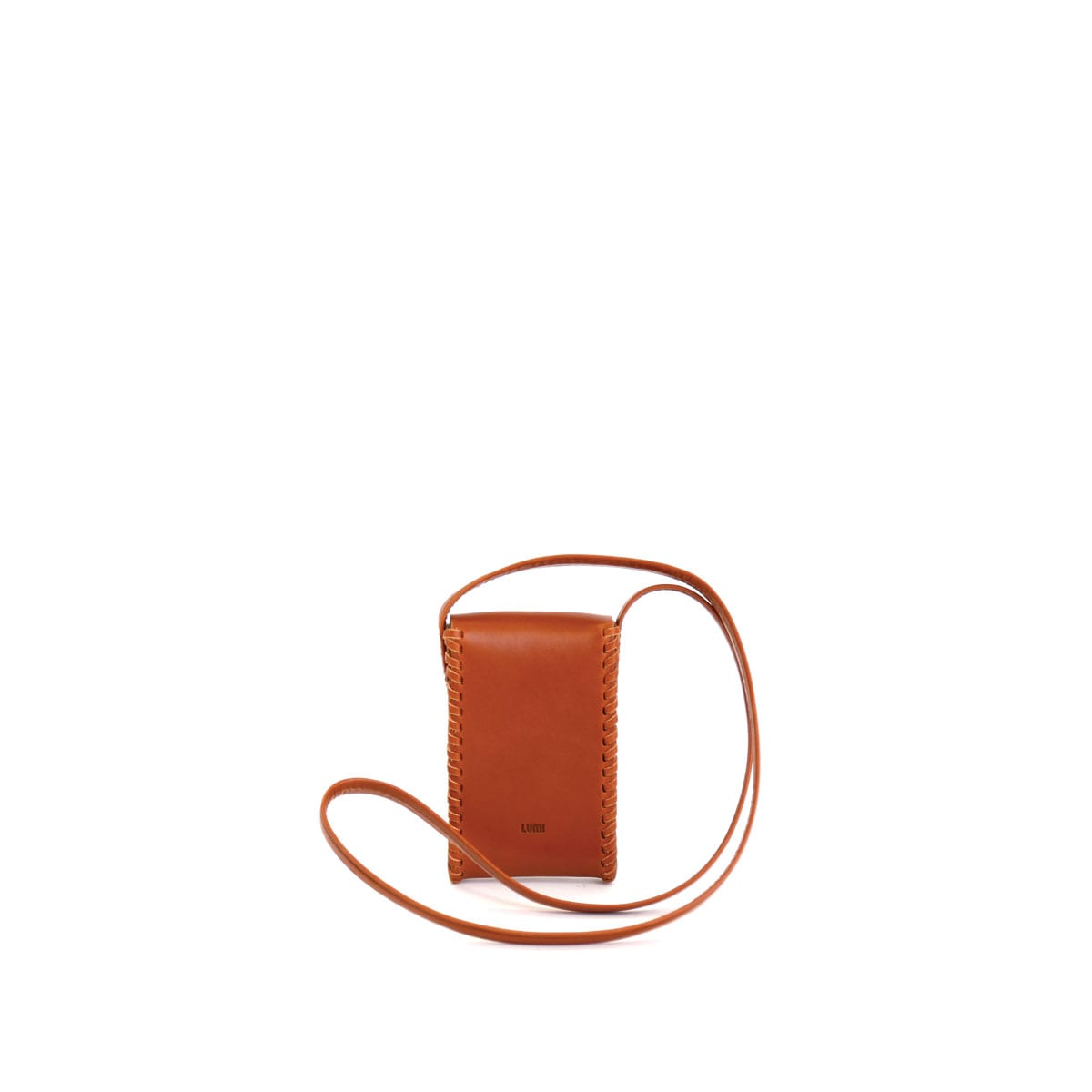 LUMI Kimmo Neck Phone Case, in cognac, is created using natural vegetable tanned cow leather. The color will naturally change over time.