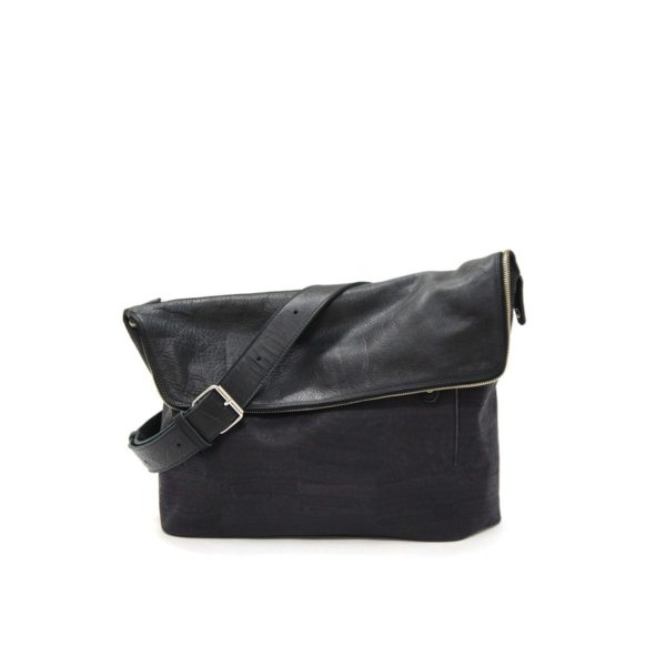 LUMI Theodore Messenger Bag, in black, is created using vegetable tanned, pull-up waxed leather.