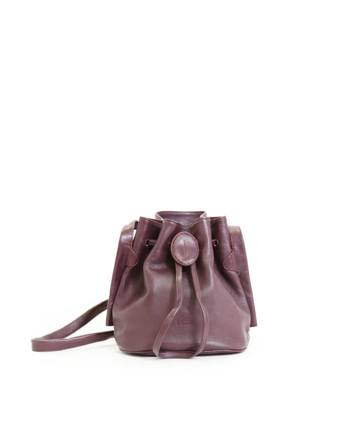 LUMI Beata Small Bucket Bag, in wine, is made of vegetable tanned goat leather.