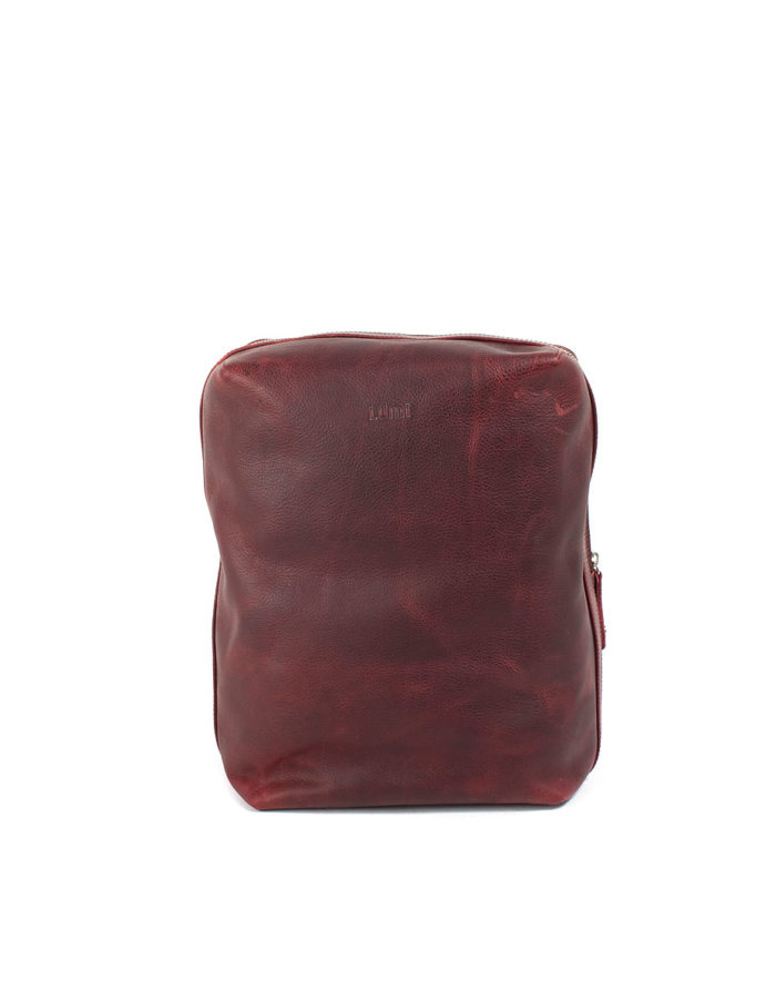 LUMI Markus Tablet Backpack, in wine, is created using vegetable tanned, pull-up waxed leather.