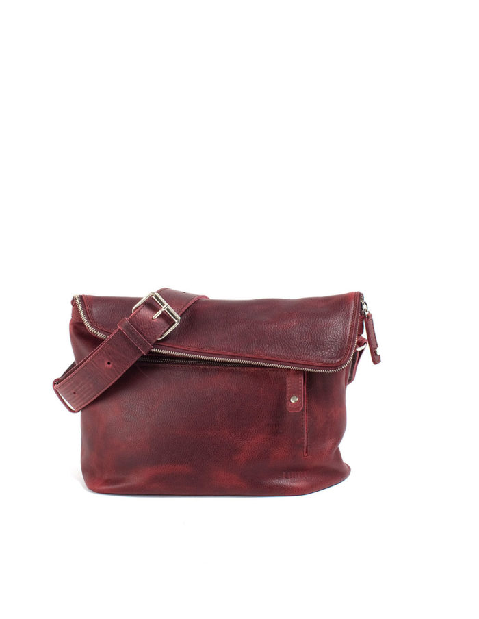 LUMI Tomi Small Messenger Bag, in wine, is all about urban functionality. Created using vegetable tanned, pull-up waxed leather.