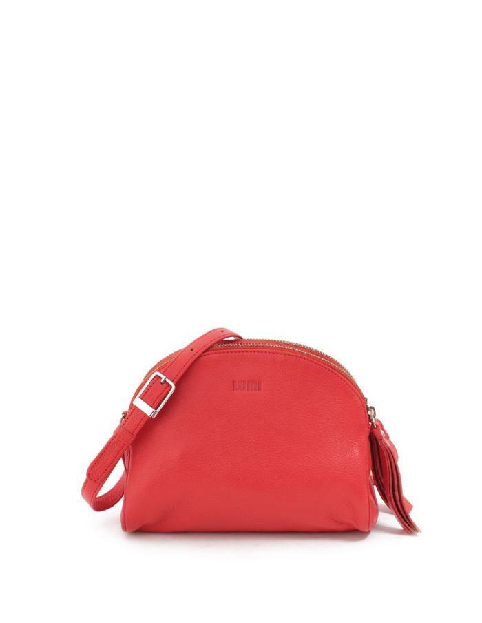 LUMI Jakita Mini Crossbody, in coral, is made of vegetable tanned goat leather. Chemical free dyeing.