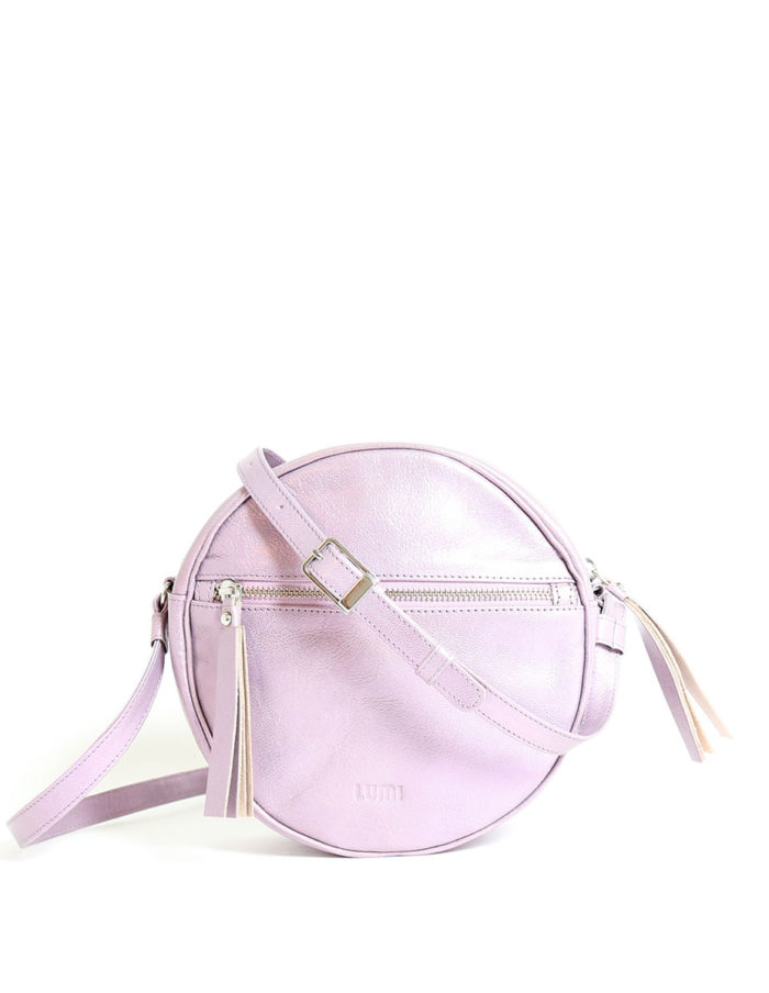 LUMI Lila Round Bag, in bougainvillea pink, is made of vegetable tanned goat leather.