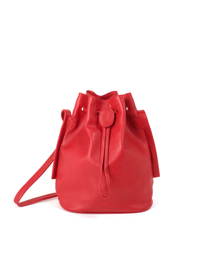 LUMI Verna Large Bucket Bag, in coral, is made of vegetable tanned goat leather. Chemical free dyeing.