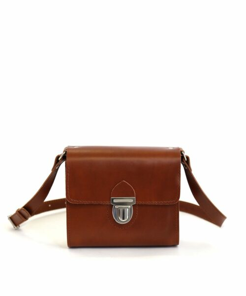 LUMI Hilla Messenger Bag, in cognac, is created using natural vegetable tanned cow leather.