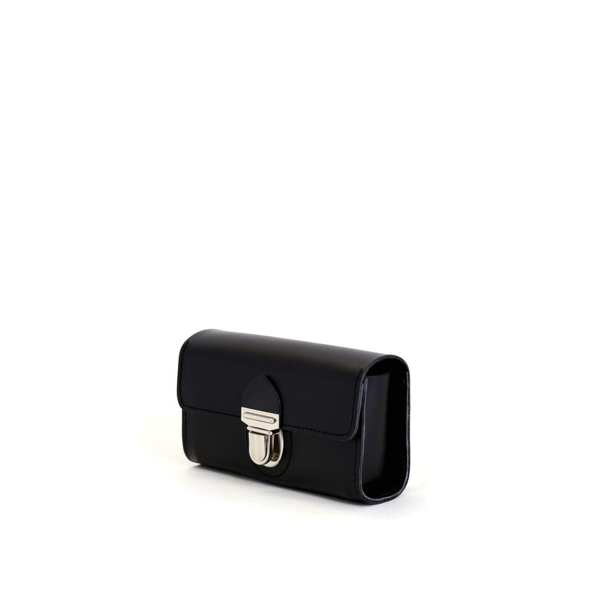 LUMI Kukka Evening Pouch, in black, is created using natural vegetable tanned cow leather. The color will naturally change over time.
