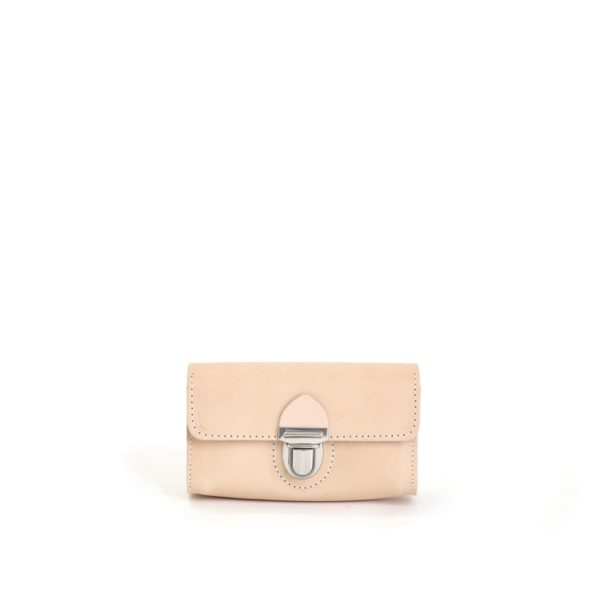 LUMI Kukka Evening Pouch is created using natural vegetable tanned cow leather. The color will naturally change over time.