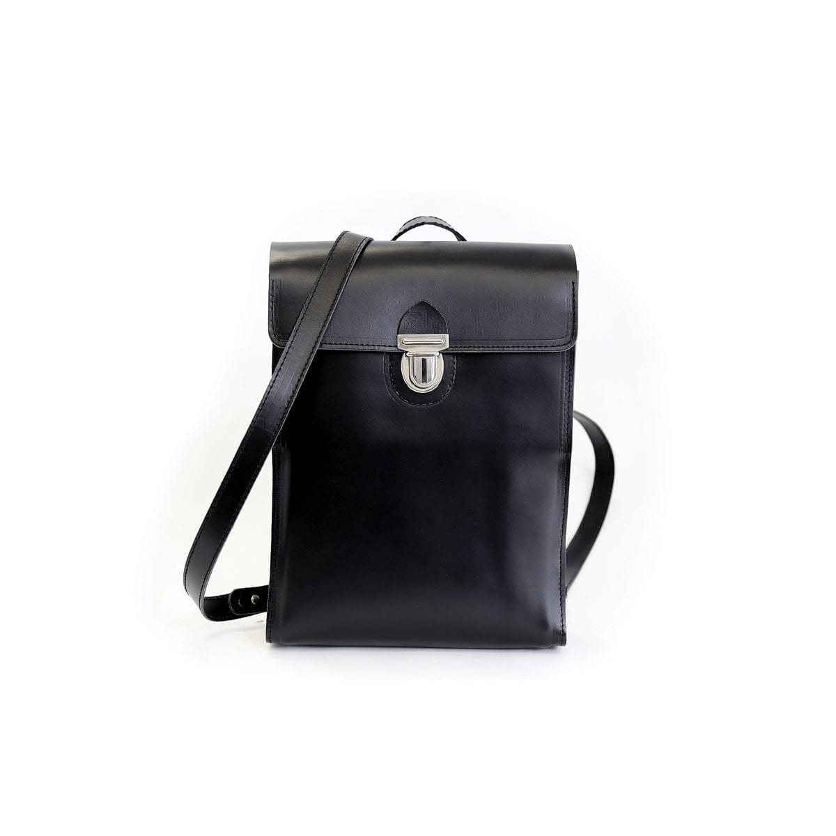 LUMI Oiva Backpack, in black, is created using natural vegetable tanned cow leather. The color will naturally change over time.