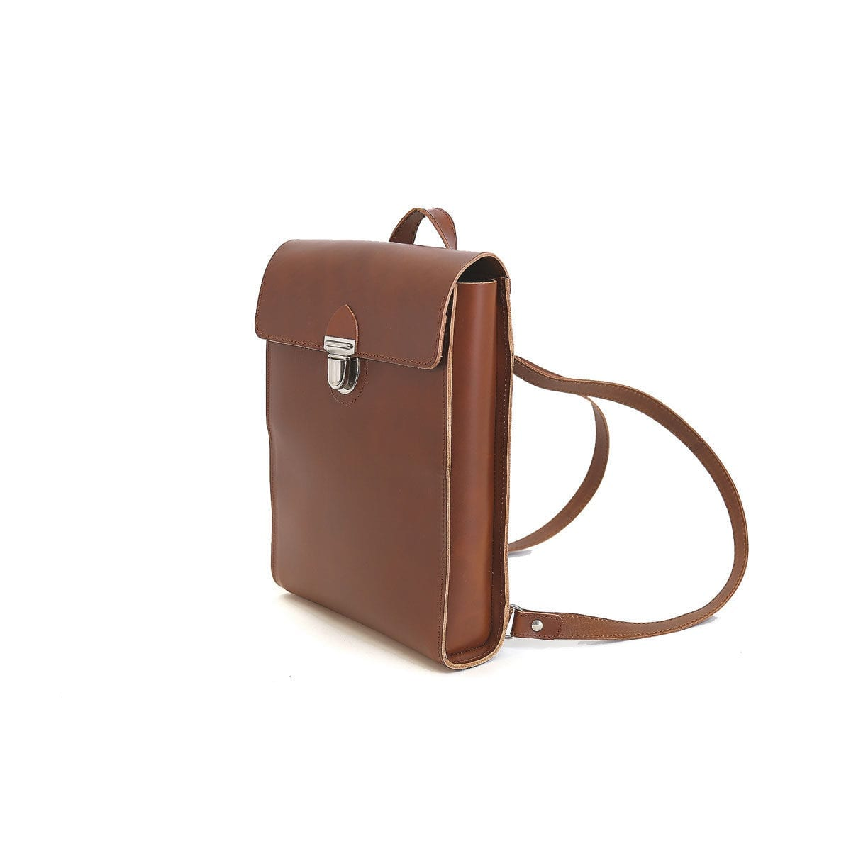 LUMI Oiva Backpack, in cognac, is created using natural vegetable tanned cow leather. The color will naturally change over time.