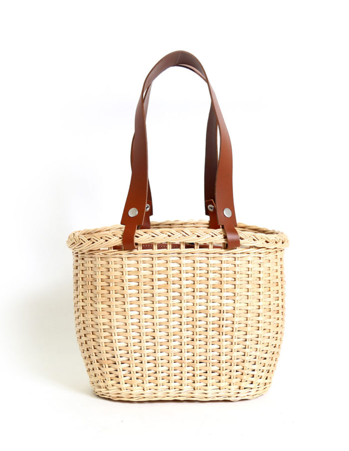 LUMI Wicker Basket, in cognac, makes a perfect companion to the beach. Or a picnic in the park.