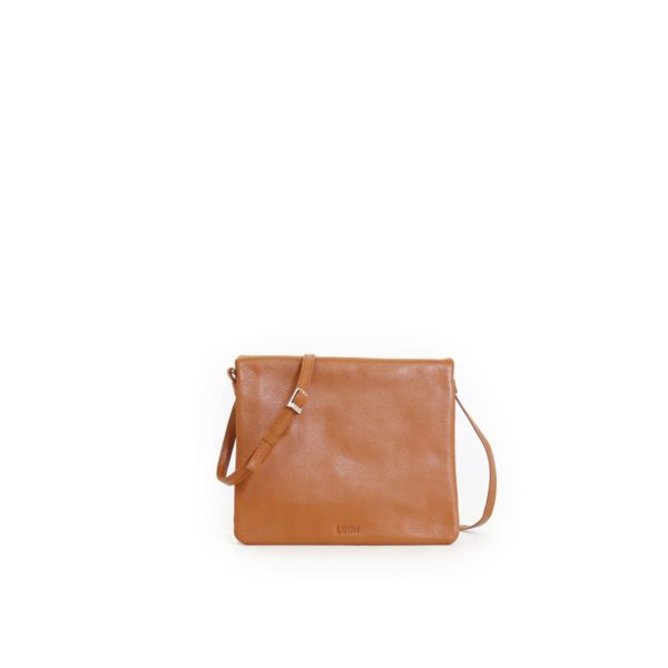 LUMI Anni Pocket Bag, in cognac, is made of vegetable tanned goat leather. Chemical free dyeing.