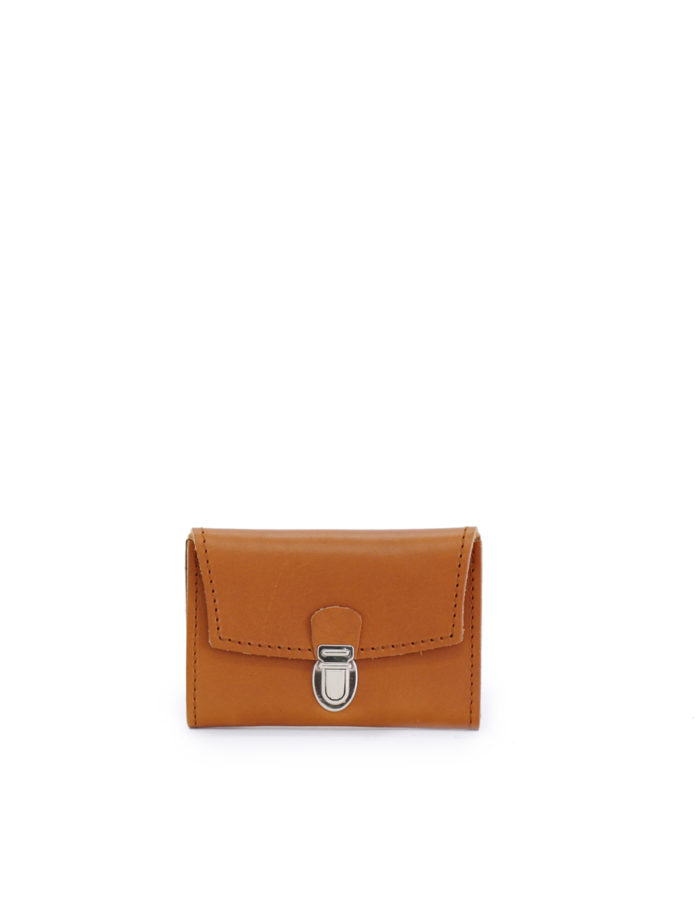 LUMI Petrus Coin Purse, in cognac, is created using natural vegetable tanned cow leather.
