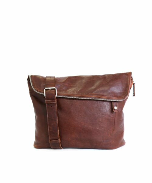 LUMI Theodore Messenger Bag in toffee brown. Theodore is created using vegetable tanned leather, so it is both handsome and ecological.