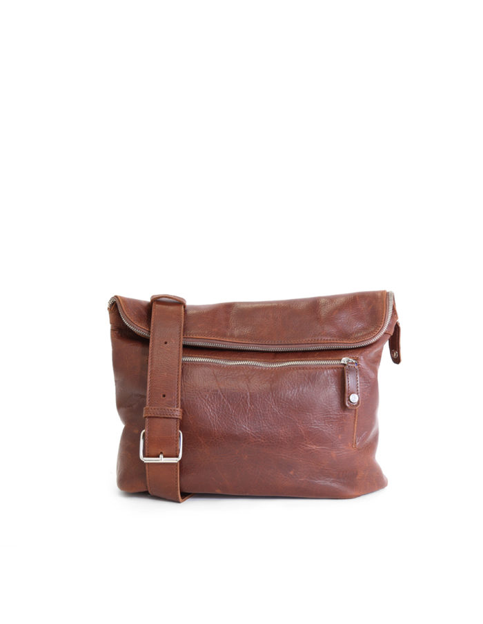 LUMI Tomi Small Messenger Bag in toffee brown. Tomi is created using vegetable tanned leather, so it is both handsome and ecological. Tomi makes a perfect companion for all urban adventures.