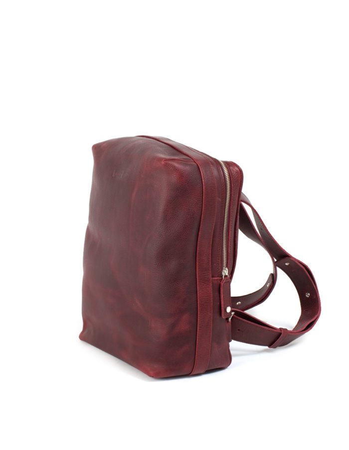 LUMI Markus Tablet Backpack, in wine. Created using vegetable tanned, pull-up waxed leather.