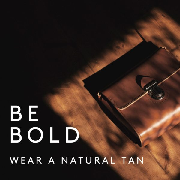 Be bold and wear a natural tan.