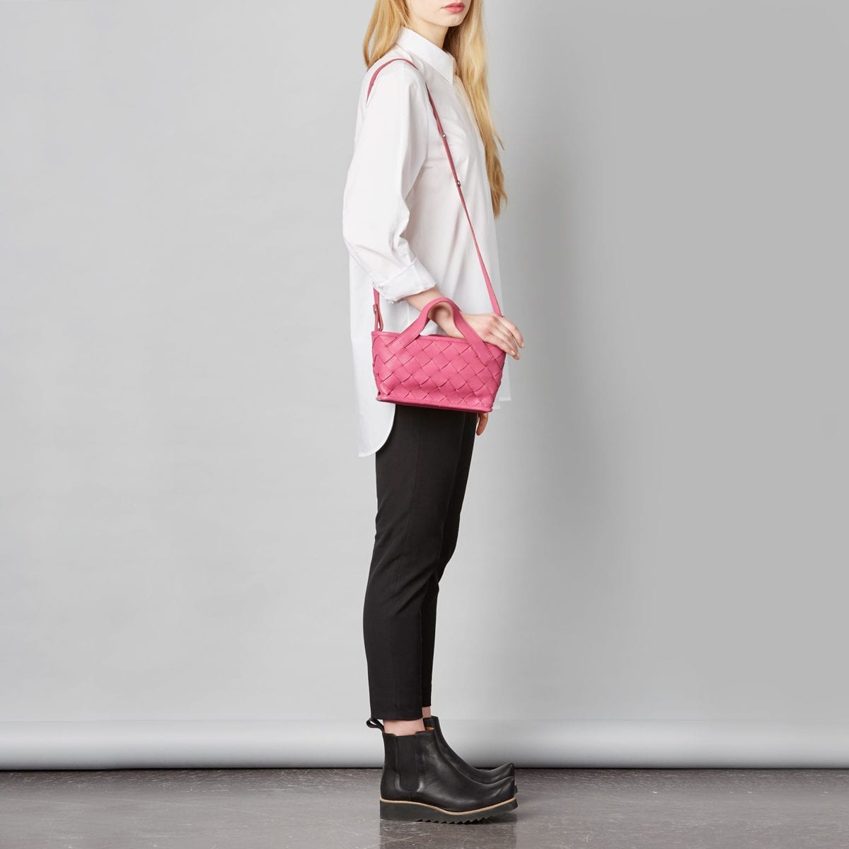 LUMI Annikki Woven Small Tote in bright raspberry colour. This cute and petite tote bag with woven textured details adds a playful twist to your daily style