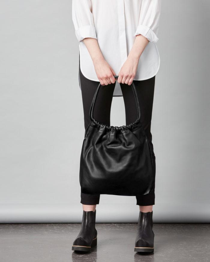 Martta Drawstring Bag in classic black.