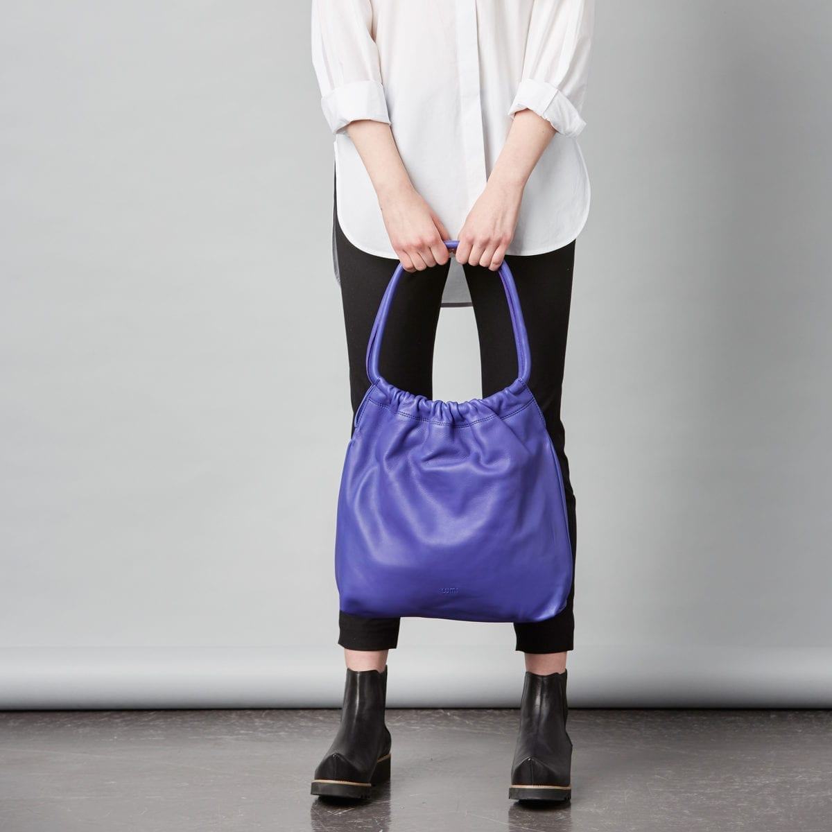 Martta Drawstring Bag in bright and bold violet.