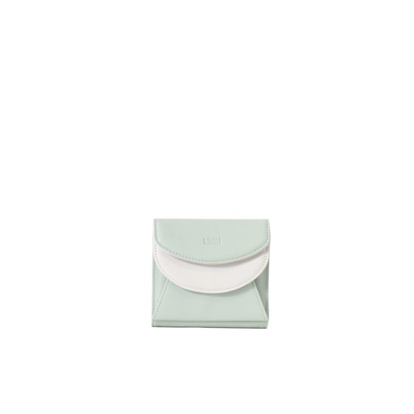 LUMI Viivi Trifold Wallet in fresh mint and white combo. This little trifold wallet safe-keeps your cards and cash in style. The wallet is handmade from lovely and soft sheep napa leather, which makes it beautiful to hold in your hand.